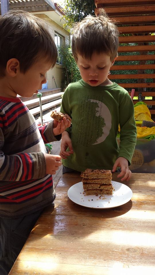 My boys devouring our bars straight out of the oven.