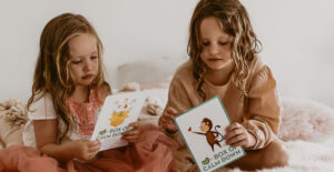girls reading box of confidence cards